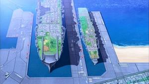 巨大なグロリアーナの学園艦(左)