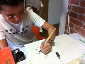 マンガを描く息子